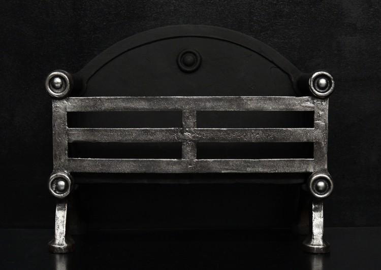 An English wrought iron firegrate