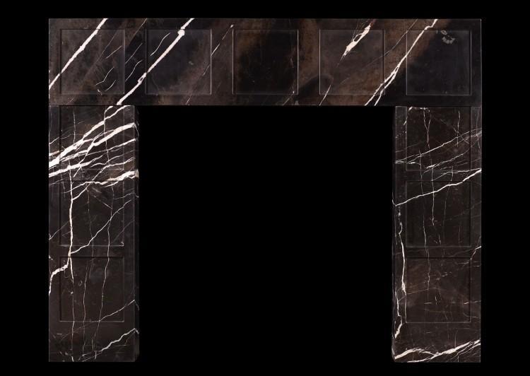 A modern brown marble fireplace with white veining