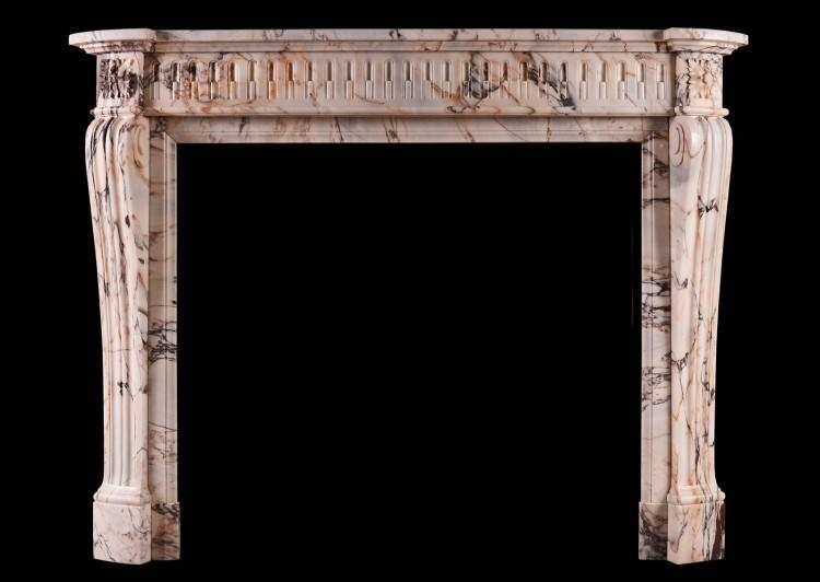 A 19th century French Louis XVI style fireplace in veined marble