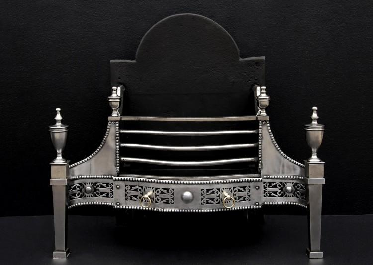 A polished steel George III style fireplace