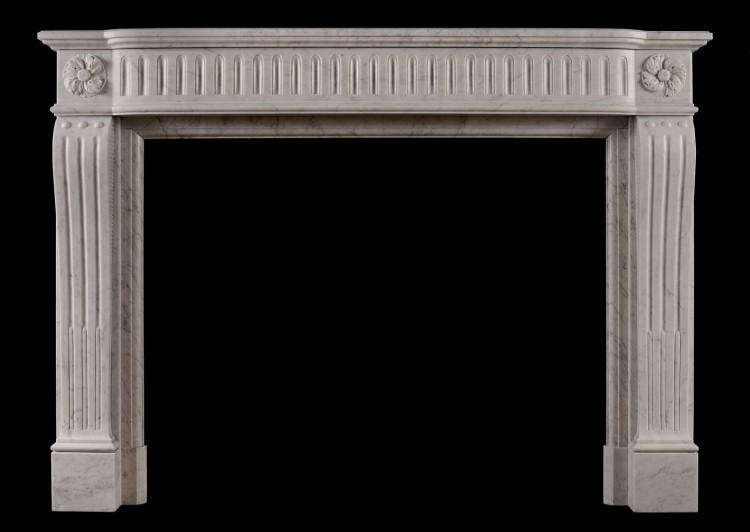 A French Louis XVI style fireplace in Italian Carrara