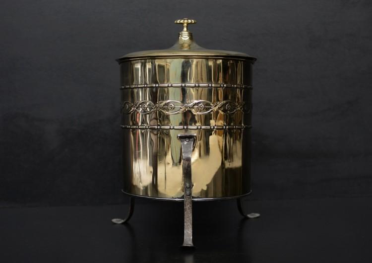 An Art Nouveau brass coal bucket
