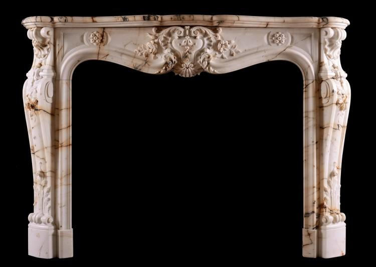A fine quality French Louis XV style fireplace in Paonazzo marble