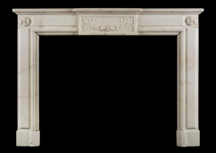 A Statuary marble Louis XVI style fireplace