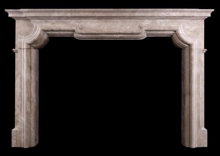 An Italian chimneypiece in white travertine