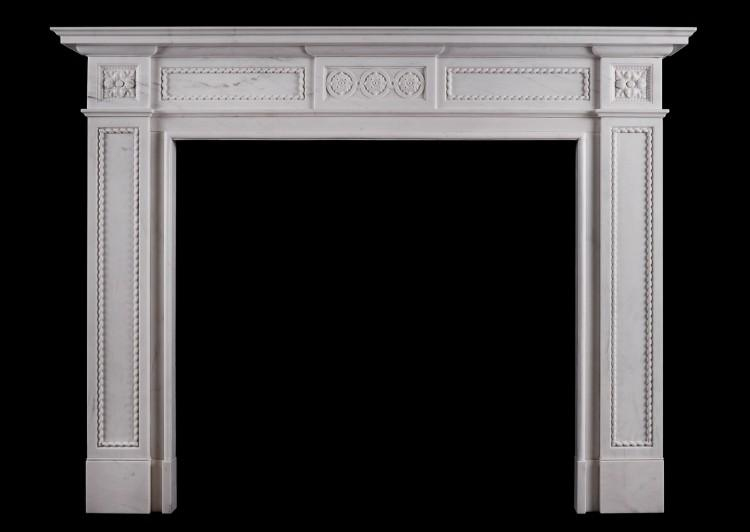 An attractive English fireplace in the Regency style