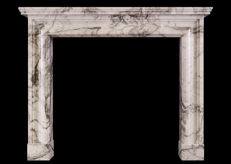 An English moulded fireplace in Arabescato marble
