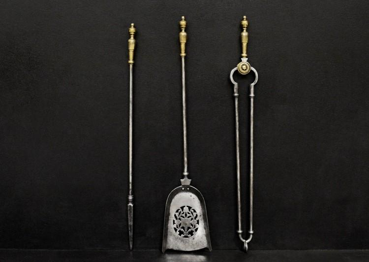 A set of brass and steel antique firetools
