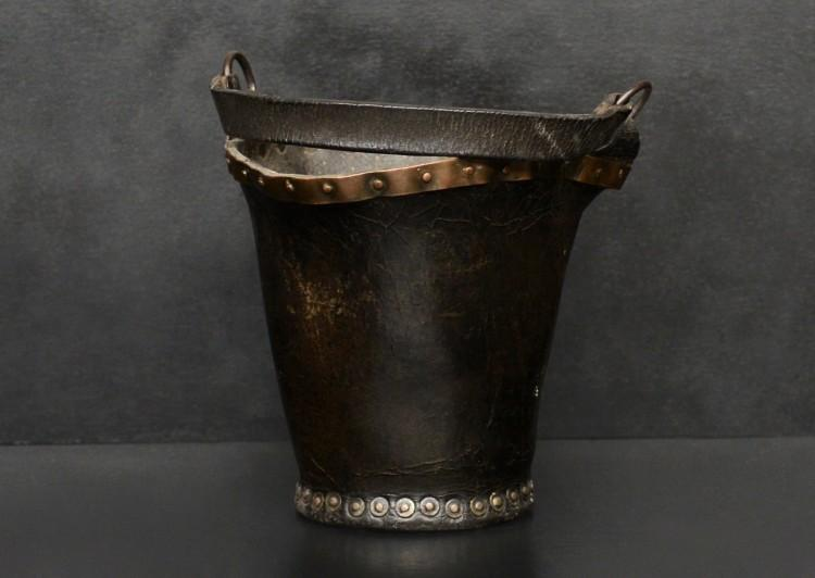 A small leather coal bucket