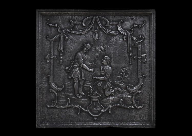 A decorative cast iron fireback