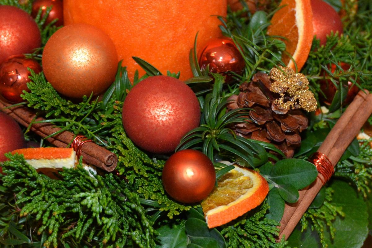 Christmas decoration with baubles, greenery, and dried fruit