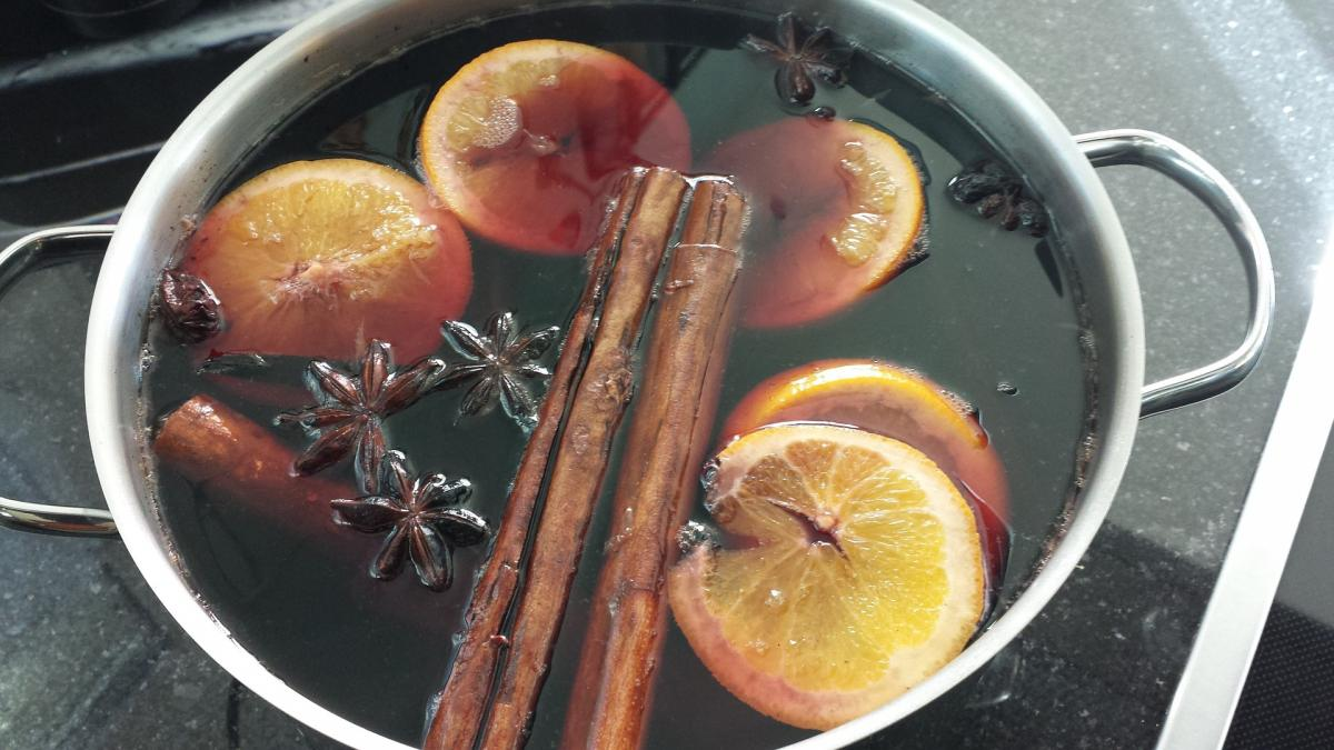 Wine, oranges and spices mulling in a pan