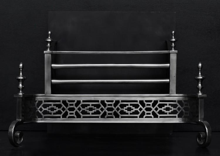 A polished steel firegrate in the Georgian style