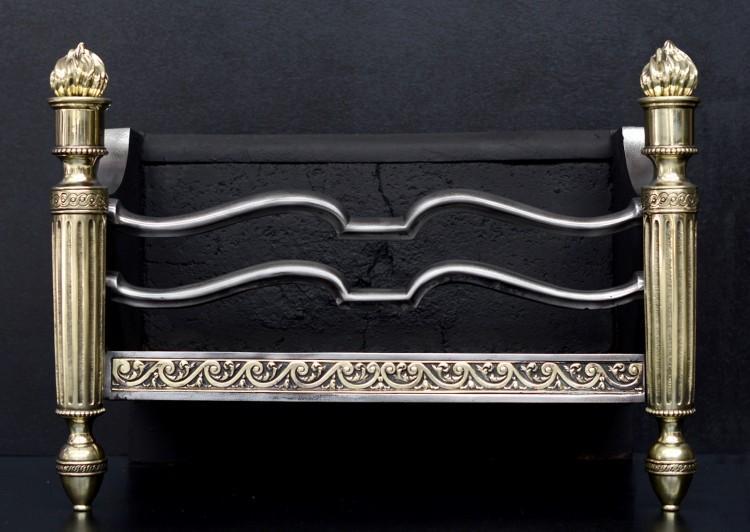 A Vitruvian scroll brass and steel firegrate