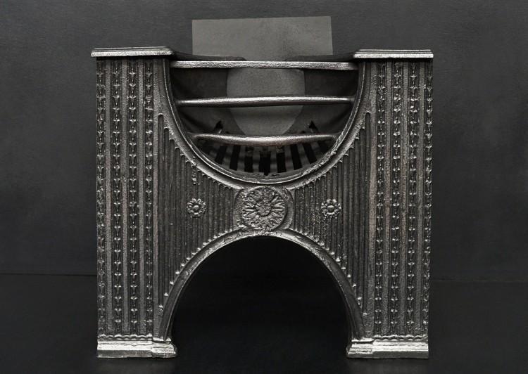A cast iron hob grate