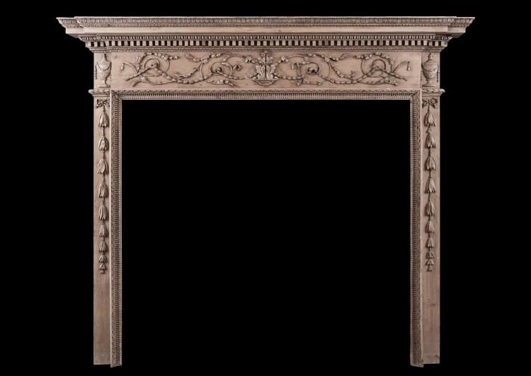 A fine quality Georgian carved pine fireplace