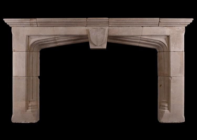 An impressive Bath stone Gothic fireplace