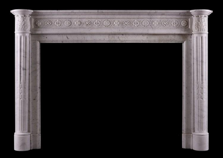 A Louis XVI style antique fireplace in Carrara marble