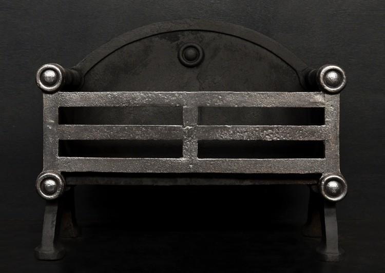 A polished cast iron firegrate