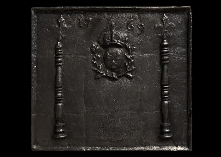 An impressive antique cast iron fireback