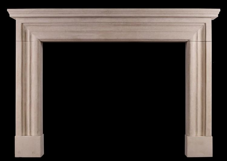 An imposing English bolection fireplace in heavily antiqued Bath stone